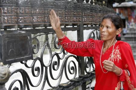 woman and prayer wheels swayambhunath temple