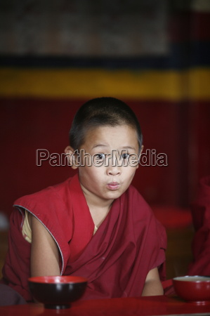 young monk swayambhunath temple kathmandu nepal