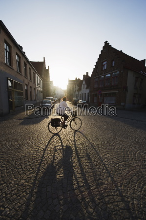 sunset and shadow of a cyclist