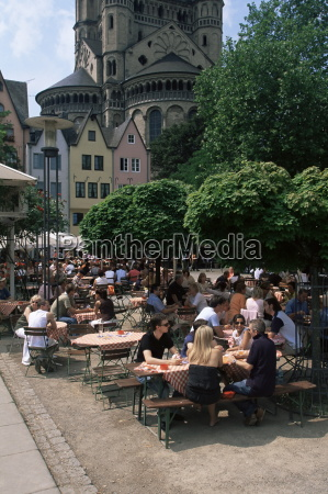 people sitting at an outdoors restaurant