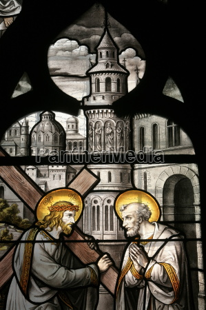 stained glass window depicting jesus and