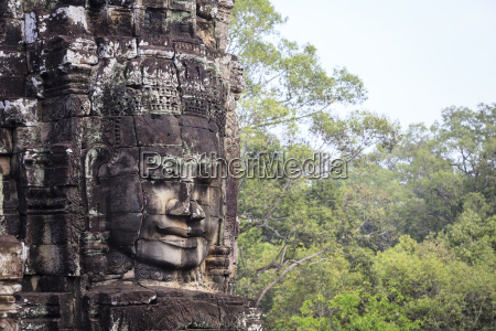 buddha face carved in stone at