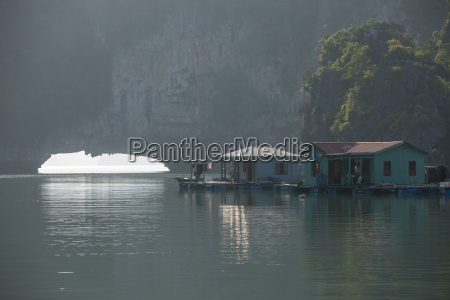 floating village and limestone caves halong