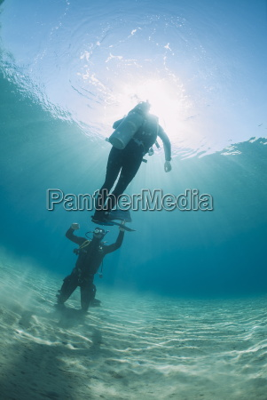 scuba diving instructor and student completing