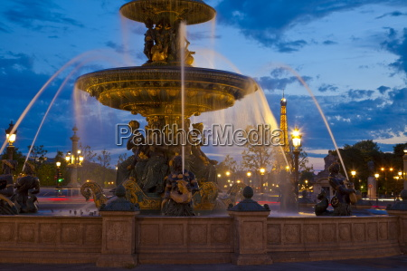 water fountain and eiffel tower at