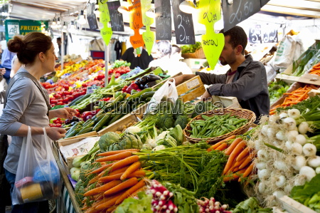 people shopping at market place monge