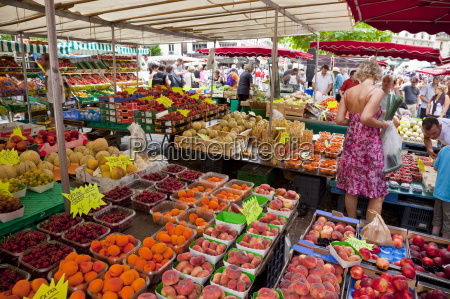 people shopping at street market rue