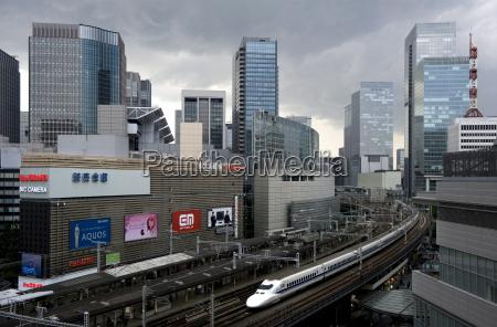 shinkansen bullet train weaving through maze