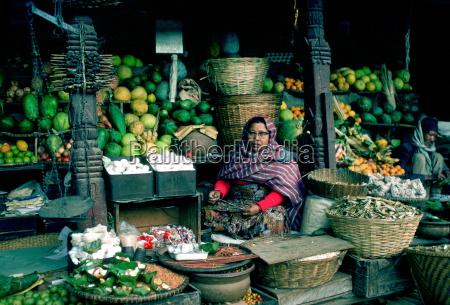 woman stallholder holding the knife she
