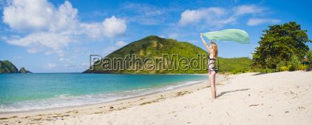 woman celebrating freedom at mawun beach