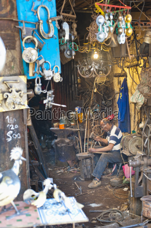 carpenter and metalworker in his workshop