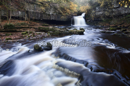 west burton waterfall in autumn wensleydale