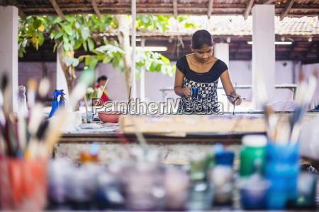 sri lankan woman batik painting near