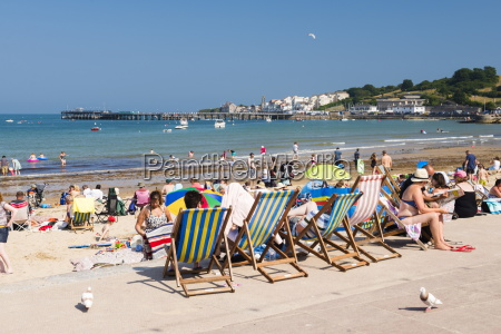 colourful deck chairs at swanage beach