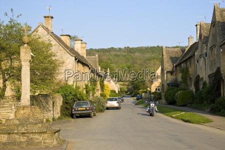 motorcyclist rides through stanton village gloucestershire