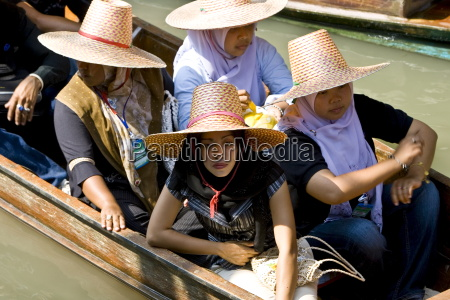 women in a boat visiting the