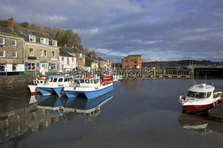 winter sunshine on fishing boats in