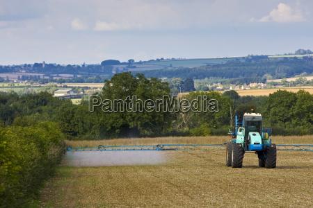 farmer sprays his crops oxfordshire united