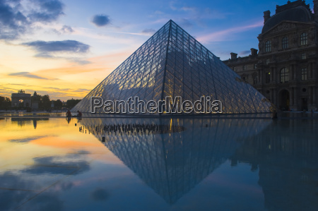 louvre pyramide at sunset paris france