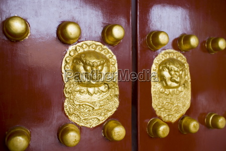 nails and lion head knockers on