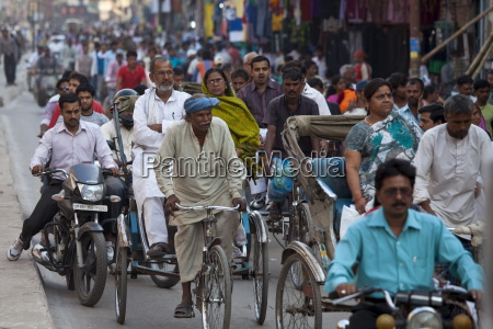 crowded street scene during holy festival