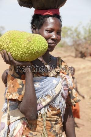 woman holding a jack fruit lira