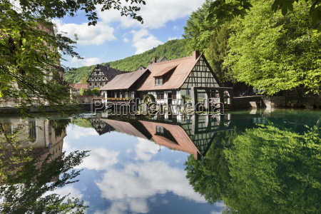 mill reflecting in blautopf spring blaubeuren