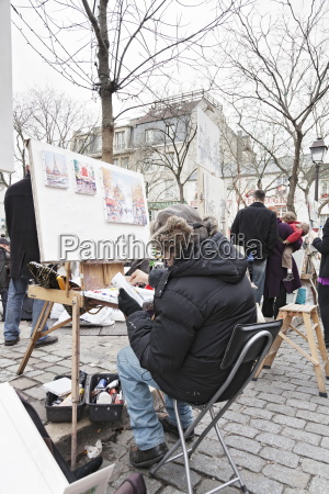painter at the art market at