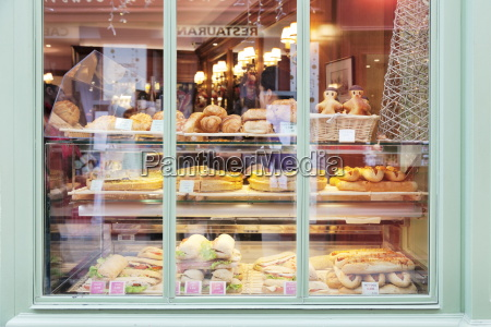 shop window with sandwiches and quiche