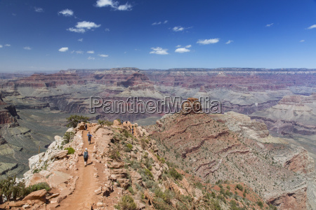 hikers descend the curving south kaibab