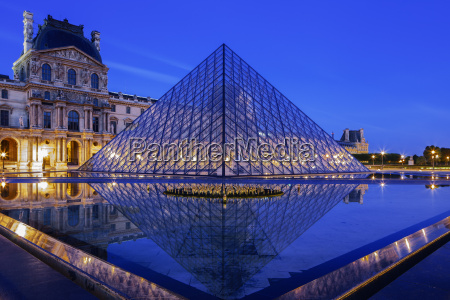 the louvre pyramid and palace reflected