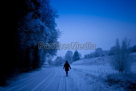 lone walker in traditional snow scene