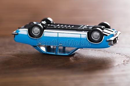 toy car on wooden desk