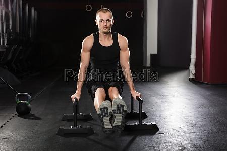 portrait of a man doing push