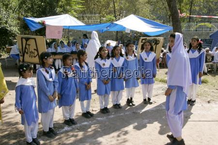 schoolchildren have lessons outdoors after earthquake