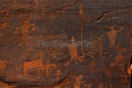horned anthropomorphs holding shields formative period