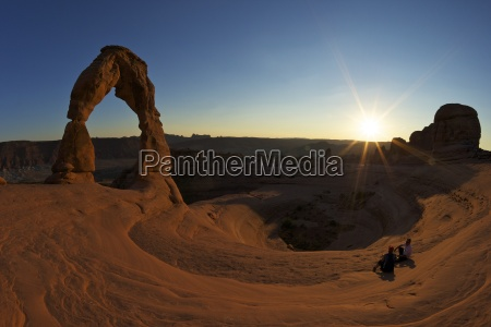 two men sitting delicate arch arches