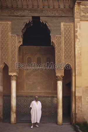 man standing at entrance of saadian