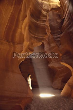 navajo man in slot canyon upper