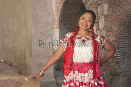 hispanic woman wearing traditional dress oaxaca