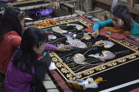 local women working on hand embroidered