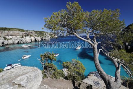 yachts anchored in cove cala macarella