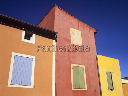 ochre tinted houses in the colourful