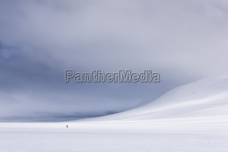 lone figure skis across rondane national