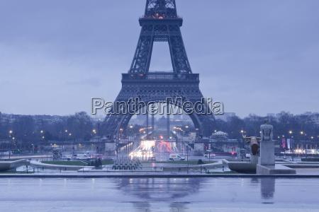 the eiffel tower under rain clouds