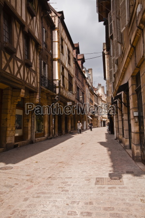 a narrow street with half timbered