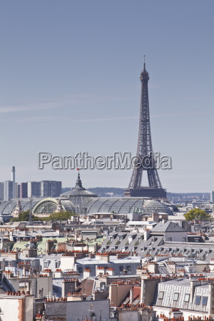 the eiffel tower rising over the
