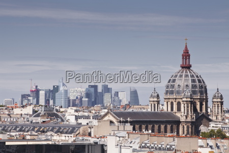 la defense rising above the rooftops