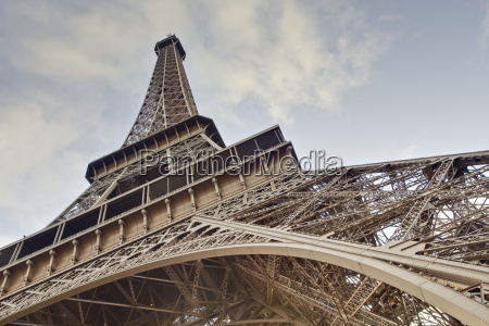 the eiffel tower towers overhead paris