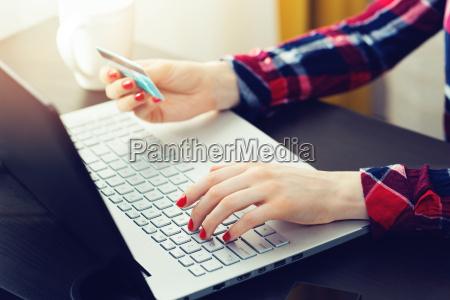 woman using laptop to make online